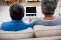 Senior couple holding hands while looking at the laptop Royalty Free Stock Photo