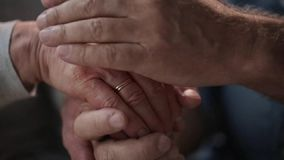 Senior couple holding hands stock video