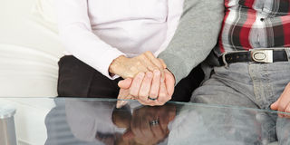 Senior couple holding hands Stock Photography