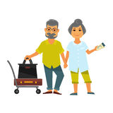 Senior couple holding hands stands near bags for travelling Stock Photo