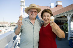 Senior Couple Holding Ice-Creams Stock Photo