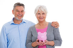 Senior couple holding piggy bank Stock Image
