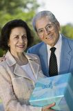 Senior couple Holding present outside Royalty Free Stock Photography