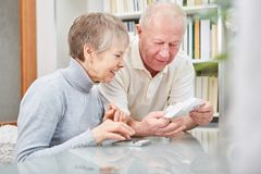 Senior couple holding receipts. For doing finance accounting Stock Photography