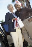 Senior Couple holding shopping bags Stock Photos