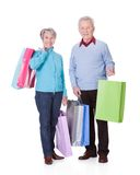 Senior Couple Holding Shopping Bags Royalty Free Stock Image