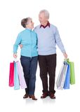 Senior Couple Holding Shopping Bags Royalty Free Stock Photography