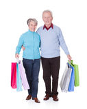 Senior Couple Holding Shopping Bags Stock Image