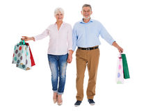Senior couple holding shopping bags Royalty Free Stock Photos