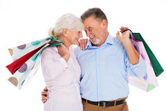 Senior couple holding shopping bags Stock Images