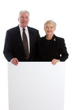 Senior Couple Holding Sign Stock Photos