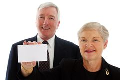 Senior Couple Holding Sign Royalty Free Stock Images