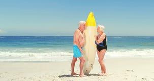 Senior couple holding surfboard stock footage