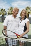 Senior Couple Holding Tennis Racquets Royalty Free Stock Images