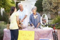 Senior Couple Holding Yard Sale Royalty Free Stock Image