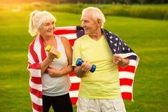 Senior couple holds dumbbells. Stock Photography