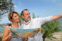 Senior couple on holidays looking at map Royalty Free Stock Images