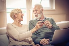 Shopping online. Senior people. stock photography