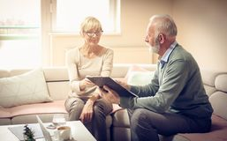 Agreement.Senior people. T home. stock image