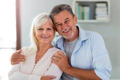 Senior couple at home. Loving senior couple at home Royalty Free Stock Photos