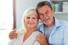 Senior couple at home. Loving senior couple at home Royalty Free Stock Images
