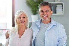 Senior couple at home. Loving senior couple at home Royalty Free Stock Photography