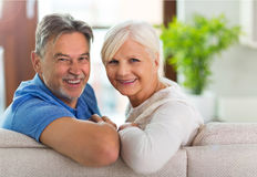 Senior couple at home. Loving senior couple at home Royalty Free Stock Image
