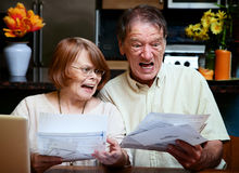 Senior couple at home with many bills Stock Images