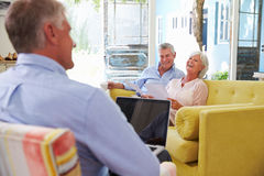 Senior Couple At Home Meeting With Financial Advisor Royalty Free Stock Image