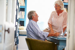 Senior Couple In Home Office Looking At Laptop Royalty Free Stock Photo