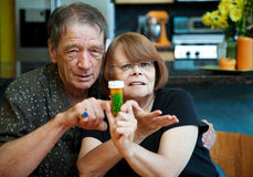 Senior Couple at Home with Prescription Stock Photo