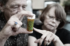 Senior Couple at Home with Prescription Royalty Free Stock Photos