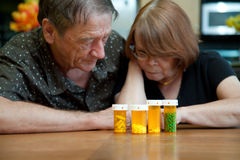 Senior Couple at Home Reading Prescription Labels Royalty Free Stock Photography
