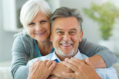 Senior couple at home. Smiling Royalty Free Stock Images