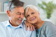 Senior couple at home. Smiling Stock Photos