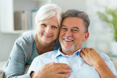 Senior couple at home. Smiling Stock Photography