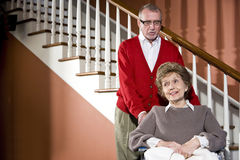 Senior couple at home, woman in wheelchair Stock Photos