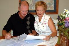 Senior couple with house plans Stock Photo