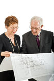 Senior couple and house plans Royalty Free Stock Image
