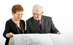 Senior couple and house plans Stock Photo