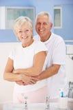 Senior couple hugging in bathroom stock photo