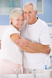Senior couple hugging in bathroom Stock Photos