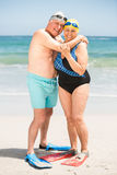 Senior couple hugging at the beach. On a sunny day Stock Image