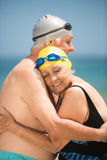 Senior couple hugging at the beach. On a sunny day Royalty Free Stock Image