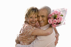 Senior couple hugging, bunch of roses, cut out stock photography