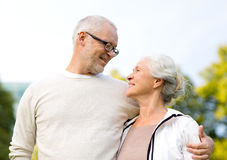 Senior couple hugging in city park Stock Photography