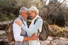Senior couple hugging forest. Romantic senior couple hugging in forest stock photography