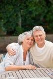 Senior couple hugging in the garden Royalty Free Stock Image