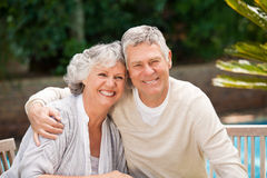Senior couple hugging in the garden Royalty Free Stock Photography