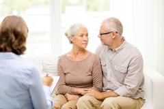 Senior couple hugging at home royalty free stock photography
